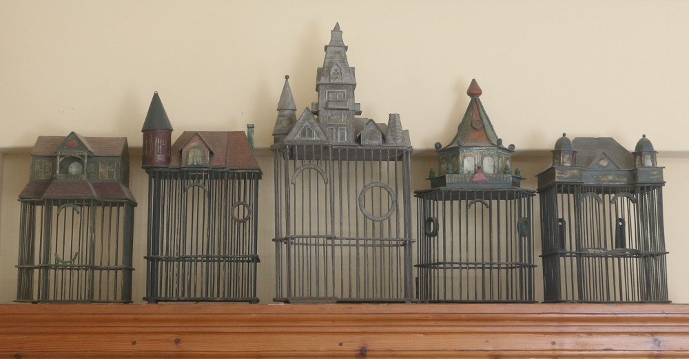 Birdcages on glasses cupboard