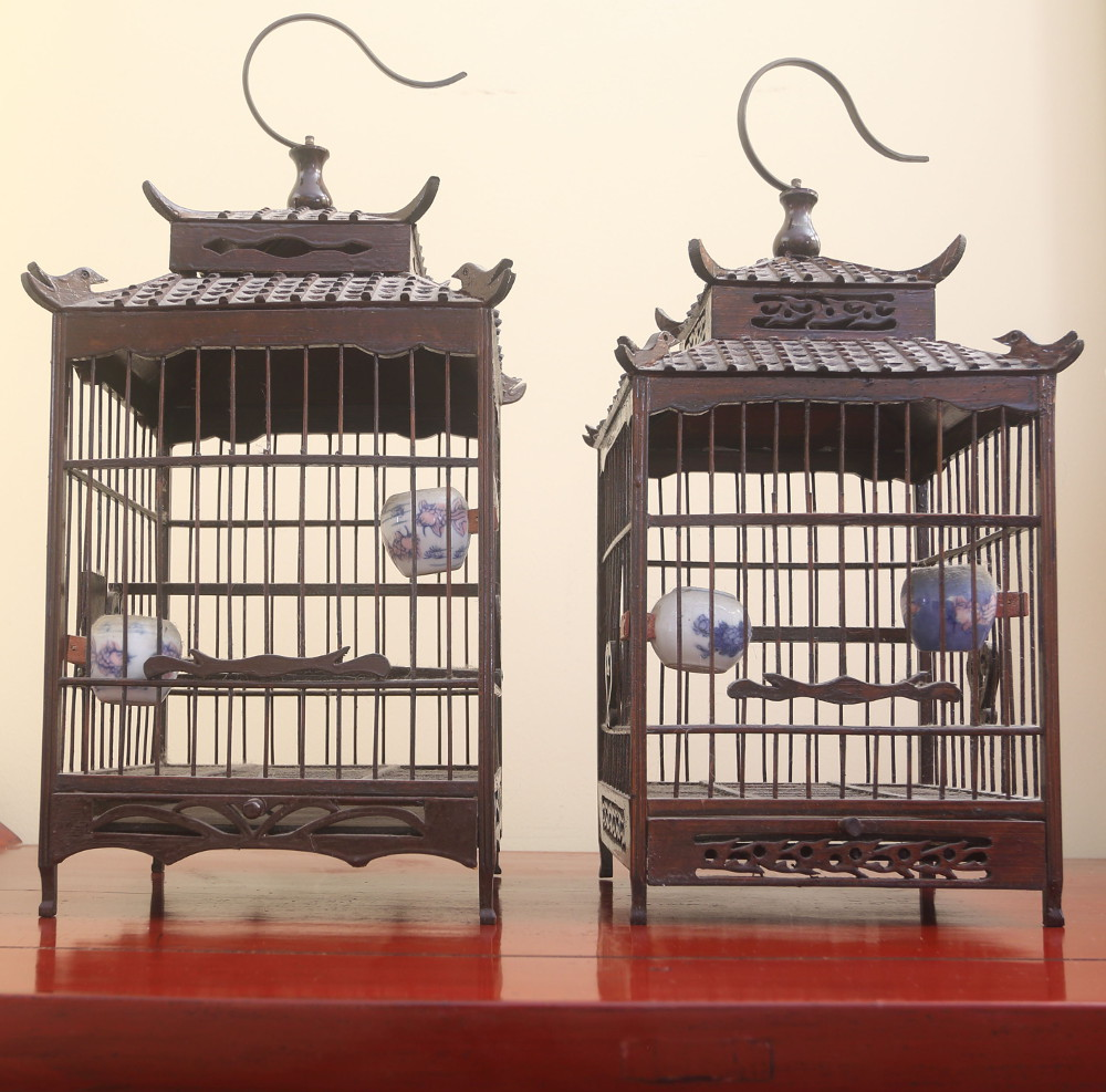 Birdcages on side table with sculpture